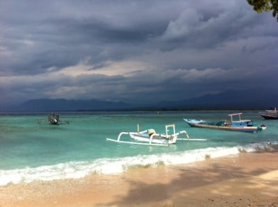 The beach in front of our homestay.  Rainclouds were a common site over Lombok, but not the gilis!