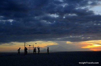 A sunset game on the west coast of Gili Trawangan, silhouetted by Bali's Mt Agung.